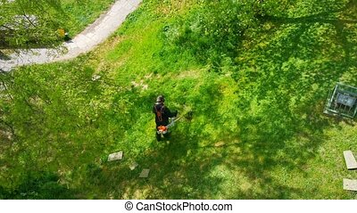 4K Overhead view of Man Mowing the Lawn