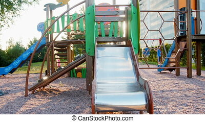 4k panning footage of empty playground with slides, swings...