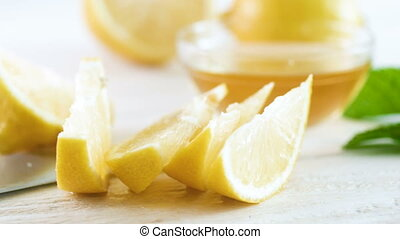 4k panning video of freshly cut lemons, knife and...