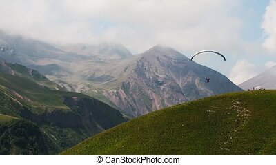 4K Paragliders fly over amazing mountain range, Georgia,...