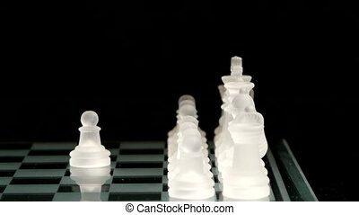 4K. Pawn move on the chessboard. black background. - Pawn...