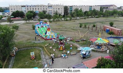 4k Playground with roundabouts where kids play with parents