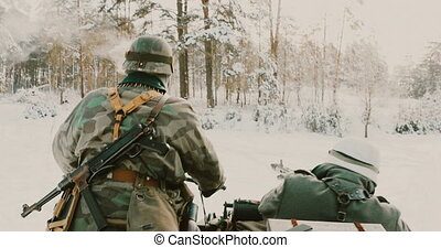4K Re-enactors Dressed As World War II German Wehrmacht Infantry Soldiers Driving Old Tricar, Three-wheeled Motorcycle And Shooting From Machine-gun in Winter Snowy Forest