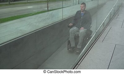 man on electric wheelchair using a ramp. Accessibility concept
