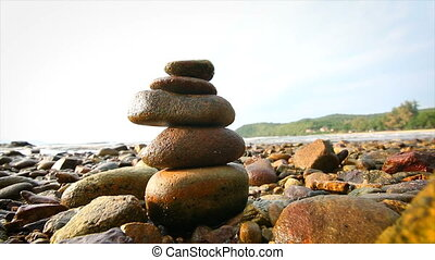 4K Rock stack balance and harmony on sea beach
