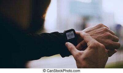 4K Runner starting smart watch timer and running. Man...