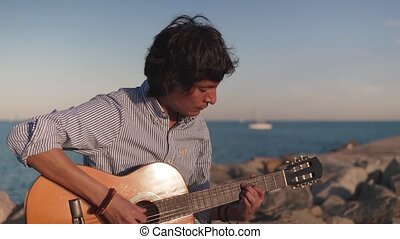 4k shot of of musician man playing acoustic guitar