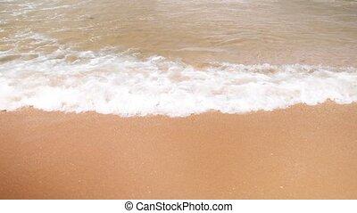 4k slow motion footage of sea waves breaking on the sandy...