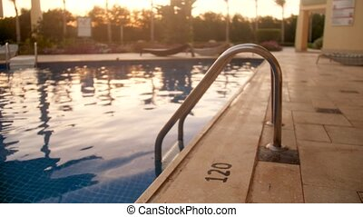 4k slow motion video of outdoor swimming pool on the villa...