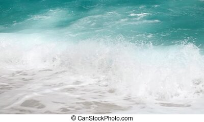 4k slow motion video of powerful turquoise sea waves...