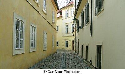 4K steadicam shot of very narrow cobblestone paved empty...