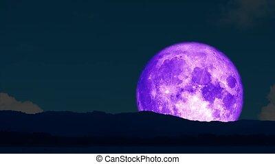 4k Super purple moon rise back on silhouette island on the night sky