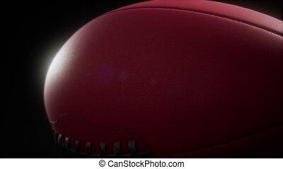 4K Super slow motion flying football on black background