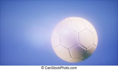 4K Super slow motion flying soccer ball on blue sky...