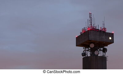 4K time lapse close up of a telecommunications tower with...