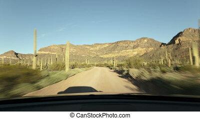 4K time lapse dusty gravel road desert