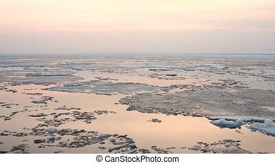 4k Time-lapse evening Ice drift on the river. In the spring the ice floats