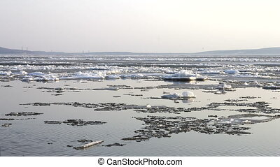 4k Time-lapse Ice drift on the river. In the spring the ice floats on the river
