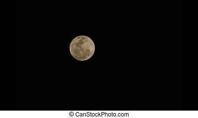 Super Full Moon passes fast across black night sky. - 4K...