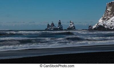 4K Time lapse Reynisdrangar cliffs tide at south coast of...
