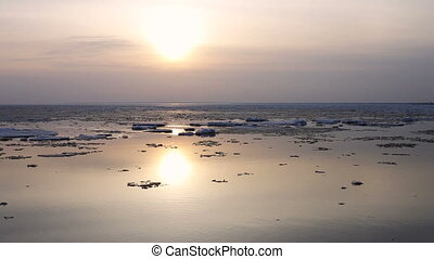 4k Time-lapse Sunset. Ice drift on the river. In the spring the ice floats