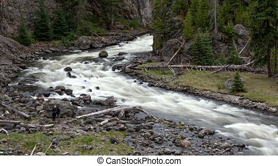 4K Time lapse tilt pan shot rough Yellowstone River