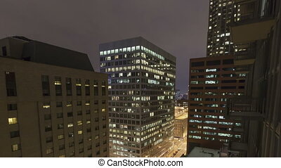 4K Time lapse tilt shot aerial traffic intersection at night