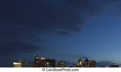 4K Time lapse tilt shot down and up Boston skyline at twilight