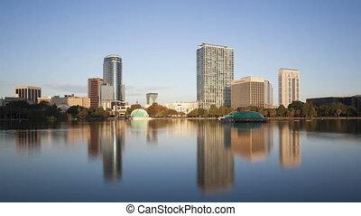 4K Time lapse zoom in Orlando skyline from Lake Eola