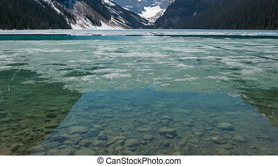 4K Time lapse zoom out broken ice on Lake Louise