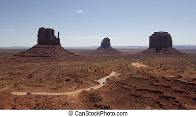 4K time lapse zoom out Monument Valley under the blue sky -...