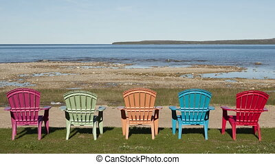 4K Time lapse zoom out shadow over colored chairs at lake