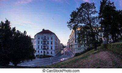 4K Timelapse of busy street in the city through dusk