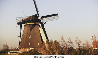 4K Traditional old Dutch rustic windmill working....