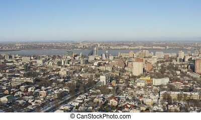 4K Urban aerial view of Dnipro city skyline. Winter cityscape background.