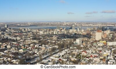4K Urban bird's eye view of Dnipro city skyline. Winter...