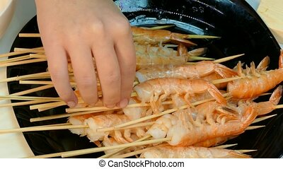 4k video. Large cooked shrimp on skewers - 4k video. Fresh...