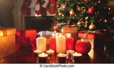 4k video of beautiful living room with fireplace and advent candles decorated for Christmas or New Year. Perfect background or backdrop for Christmas or New Year