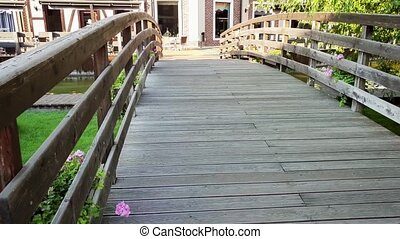 4k video of beautiful old wooden bridge with flower pots...