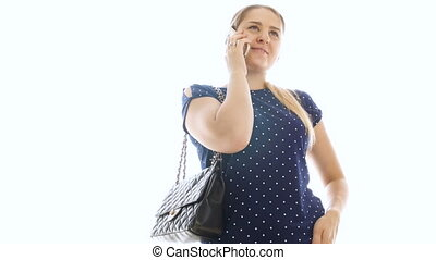 4k video of beautiful smiling woman talking by phone against white background