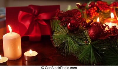 4k video of beautiful wooden table in living room decorated for Christmas with gifts, wreath and candles. Perfect background or backdrop for Christmas or New Year