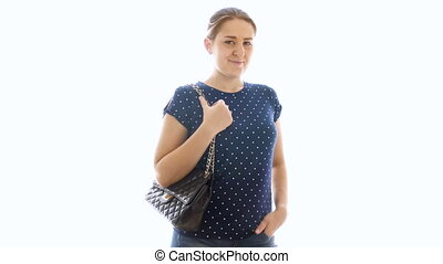4k video of beautiful young woman with handbag posing at camera against white background