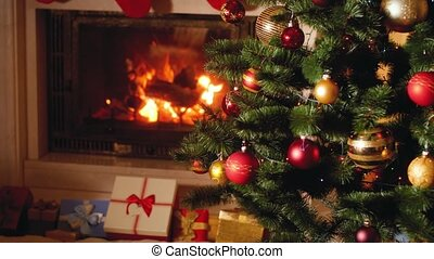 4k video of big heap of gifts and present next to burning ...