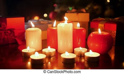 4k video of burning advent candles and boxes with gifts and presents from Santa. Perfect background or backdrop for Christmas or New Year