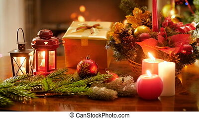 4k video of burning candles and fireplace in living room deocrated for celebrating Christmas and New Year. Perfect shot for winter celebrations and holidays