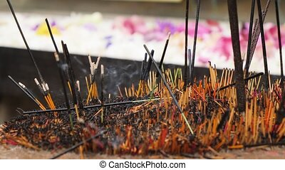 4k footage of burning incense sticks on the altar at buddhist temple