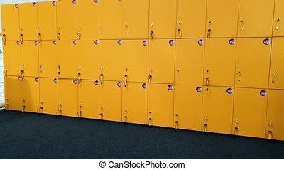 4k video of camera panning along row of locker doors in the...