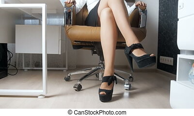 4k video of elegant busineswoman with long sexy legs in high...