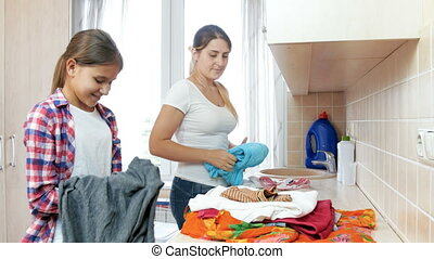4k video of family douing housework in laundry at house