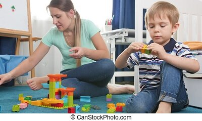 4k video of little toddler boy building tower of colorful ...
